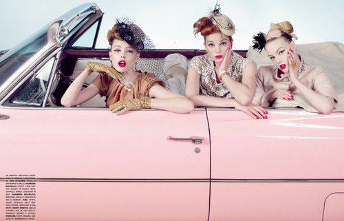 Women in a pink car